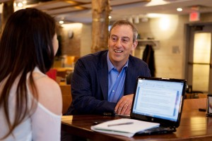 Joshua Macht '91, executive vice president and publisher of the Harvard Business Review Group, meets with Shaina Lam '17 of Portland, Maine, in the Den during his Voices in Entrepreneurship visit in March.  (Sarah Crosby/Bates College)