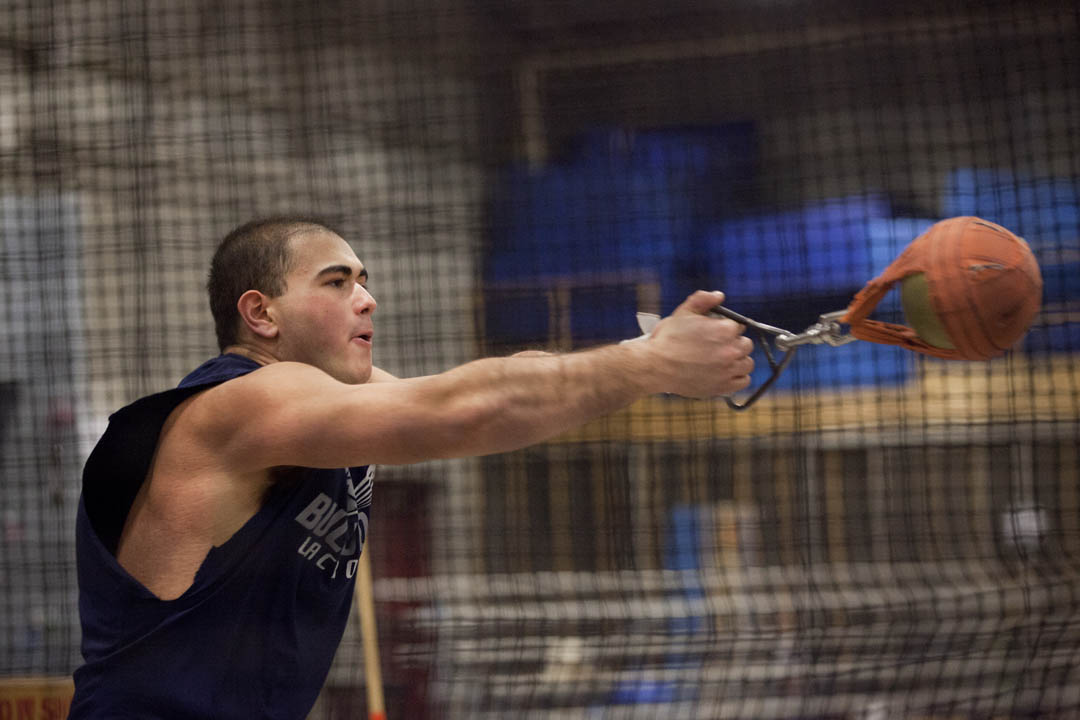 """""""It's 35 pounds, so with that much weight you have to rely on technique and form first. Then you can apply your power,"""" says Nick Margitza '16, of Waterville, a thrower on the men's track team. (Phyllis Graber Jensen/Bates College)"""
