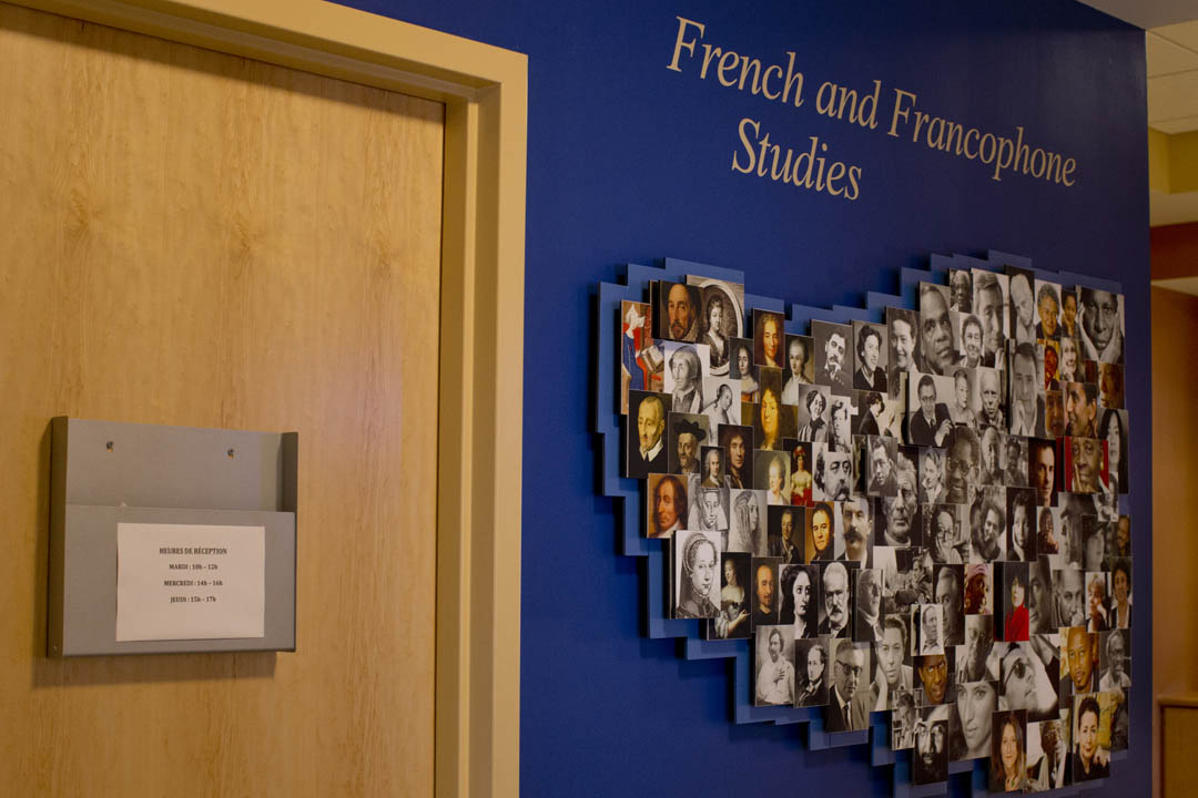 A display of famous French and Francophone faces -- artists, writers and scientists -- embellishes a Roger Williams Hall wall in the Department of French and Francophone Studies. (Phyllis Graber Jensen/Bates College)