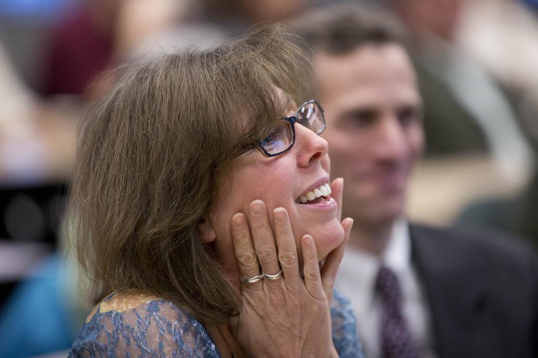 Lynne Lewis reacts to introductory remarks made by President Clayton Spencer during events held to honor Lewis' appointment as the Elmer W. Campbell Professor of Economics. (Phyllis Graber Jensen/Bates College)