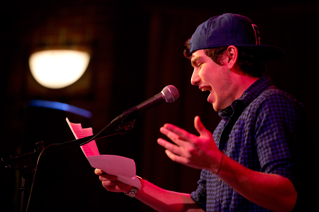 Jeremy Mack '16 of Brooklyn performs his poetry at the the Benjamin Mays Center as part the Village Club Series' Student Poetry Slam. (Phyllis Graber Jensen/Bates College)
