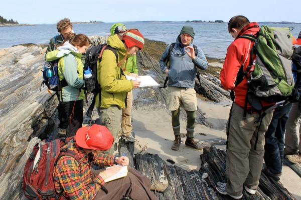 During a field trip to Cliff Island, Professor of Geology Dykstra Eusden '80 teaches students how to identify and measure different rock formations in order to create a map in ArcGIS, a mapping and spacial analysis tool. (Judson Peck '11)