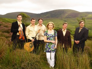 The popular traditional Irish band Danú against an Irish landscape, taken by Colm Henry.