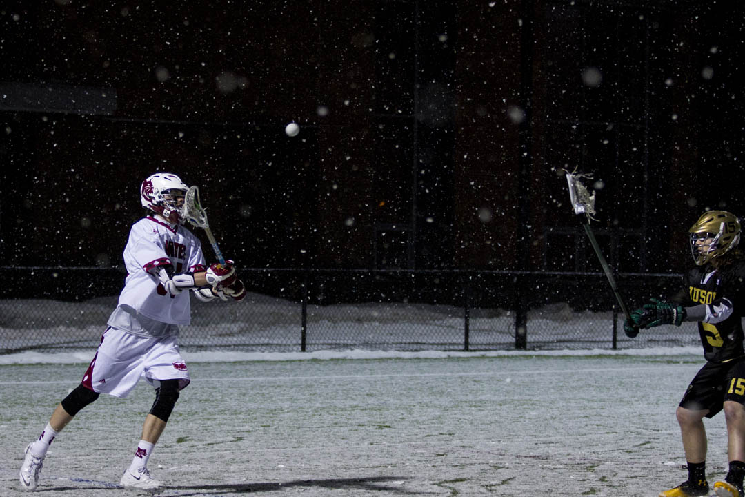 The game sees attackman Andrew Melvin '17 of Medfield, Mass., score his first two collegiate goals and assisting on two others. (Sarah Crosby/Bates College)