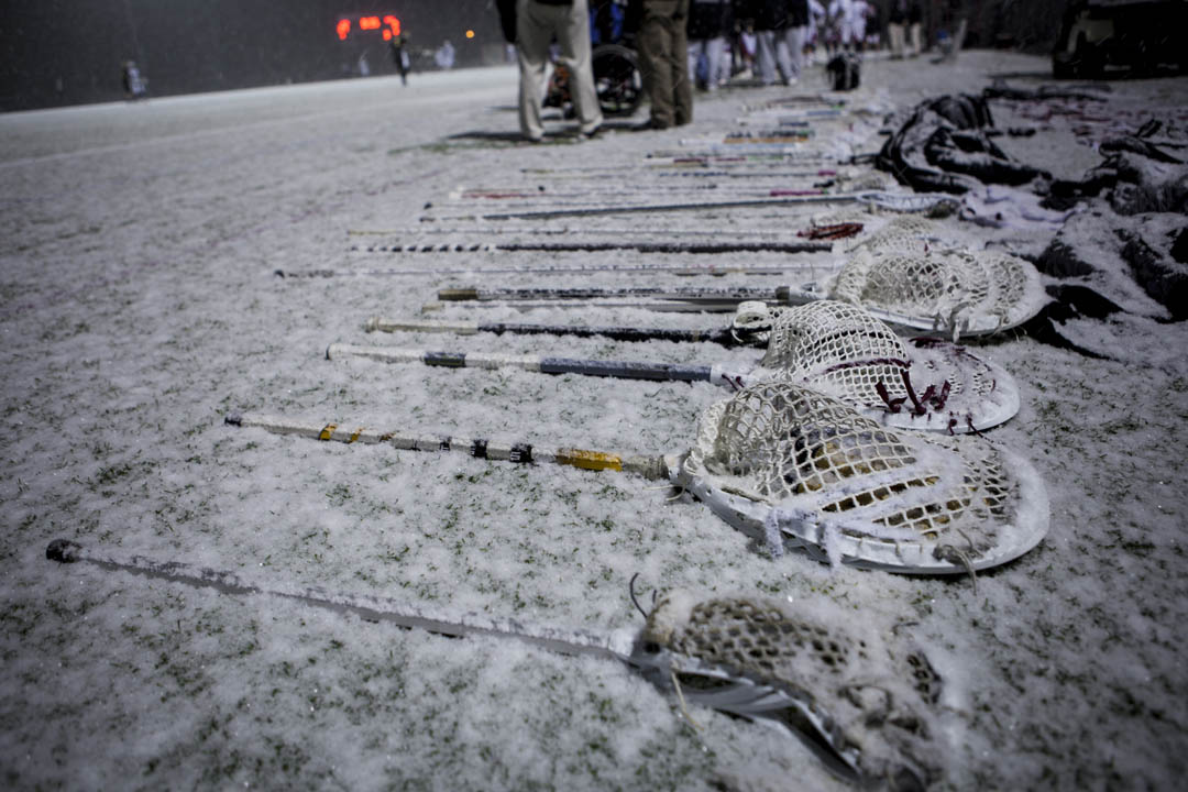 The snow begins to pile up during the fourth quarter, making the ball harder to see and causing this equipment seemingly to disappear. (Sarah Crosby/Bates College)