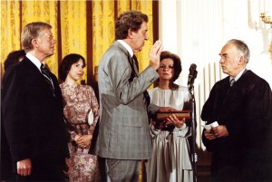Edmund Muskie '36 is sworn in as U.S. secretary of state by longtime friend and adviser Frank Coffin '40, a federal judge at the time. Looking on are, from left, President Jimmy Carter; Muskie's daughter Ellen Muskie Allen; and his wife, Jane Muskie.