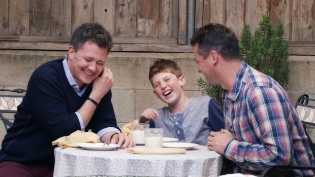 "A screen capture of an ad from the Honey Maid ""This is Wholesome"" campaign, featuring a gay male couple who have two children."