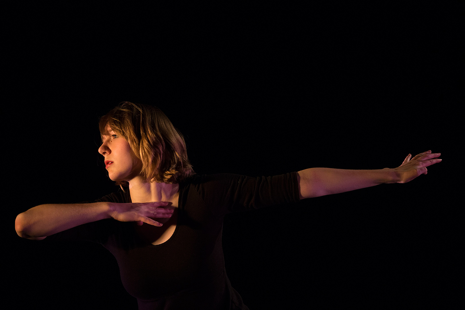 "On the Schaeffer Theatre stage, Katie Ailes '14 performs ""Homing,"" a work she choreographed for her senior thesis in dance. (Phyllis Graber Jensen/Bates College)"