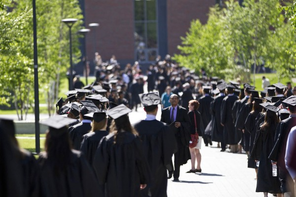 Soon-to-be alumni line up on Alumni Walk just prior to Commencement 2012. (Phyllis Graber Jensen/Bates College)