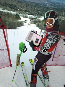 The Judges' Choice photograph by Avril Dunleavy '15 features fellow alpine racer Kathleen Fitzpatrick '15 posing between runs during a pre-season meet at Sunday River.