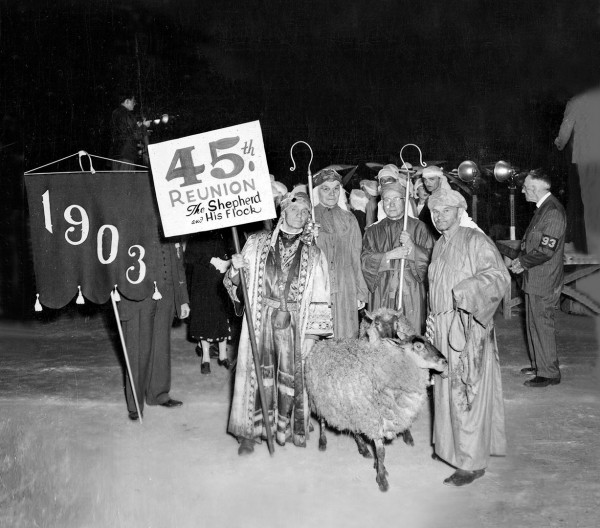 """In 1948, this """"display of livestock"""" won  best costume for the Class of 1903. The sign holder, Class President Alexander Maerz, is next to classmates George Ramsdell, a longtime Bates math professor, and Carl Sawyer. Ralph Johnson, right, wrangled the sheep for the class. Photograph courtesy of the Edmund S. Muskie Archives  and Special Collections Library"""
