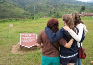"""Bates students visit the Murabi Genocide Memorial site in 2009 as part of Alex Dauge-Roth's Short Term course """"Learning with Orphans of the Rwandan Genocide."""" More than 50,000 people were massacred at the site."""