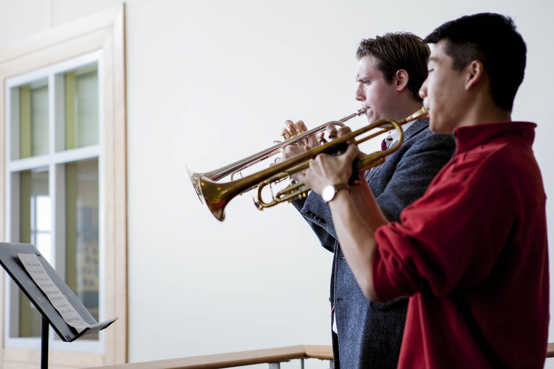 "From left, Alexander Perrone '16 and James Jhun '16 play Michael Rondeau's ""Fanfares of St. Charbel"" to celebrate the start of the 13th annual Mount David Summit in Pettengill Hall on March 28, 2014. (Sarah Crosby/Bates College)"