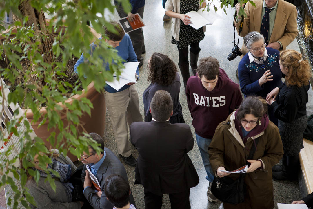 Summit students and visitors fill Perry Atrium in Pettengill Hall. Student researchers presented posters in three separate sessions. (Sarah Crosby/Bates College)