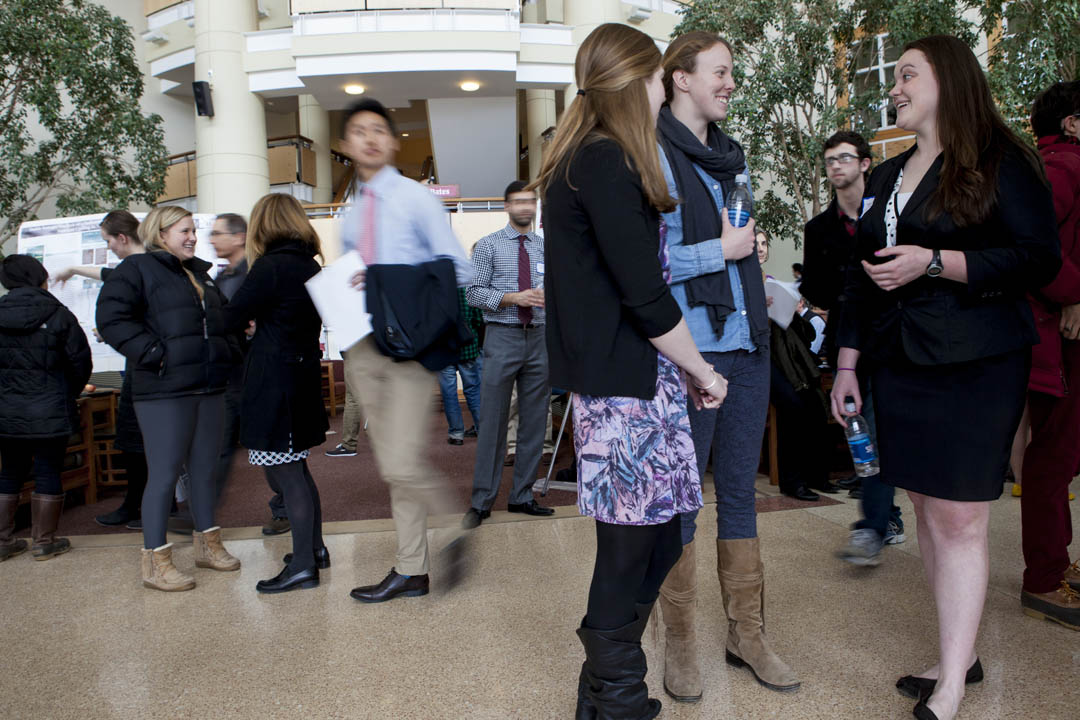 Conversation and crowds animate Perry Atrium during the Summit. (Sarah Crosby/Bates College)