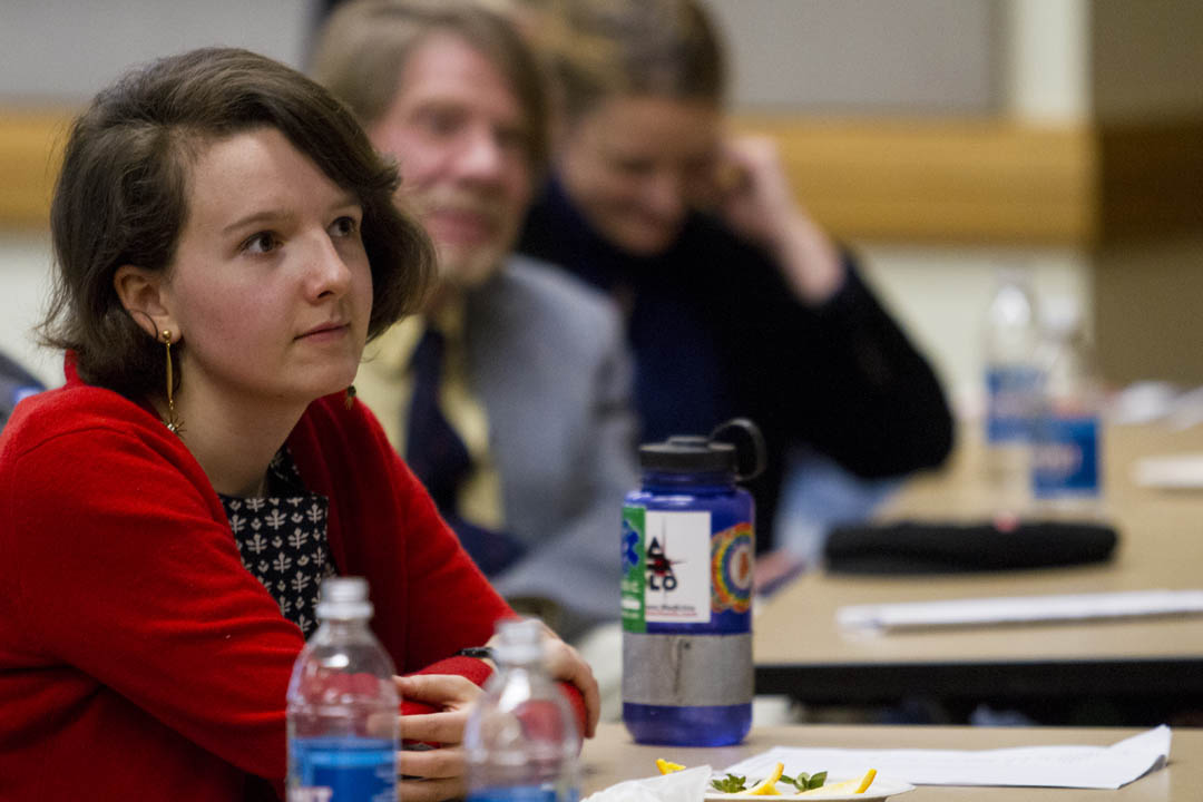 A captivated audience, including Emma Timbers '14 and Senior Lecturer Rob Farnsworth, listens as English major Kayla Herz '14 offers a reading from her creative writing thesis. (Sarah Crosby/Bates College)