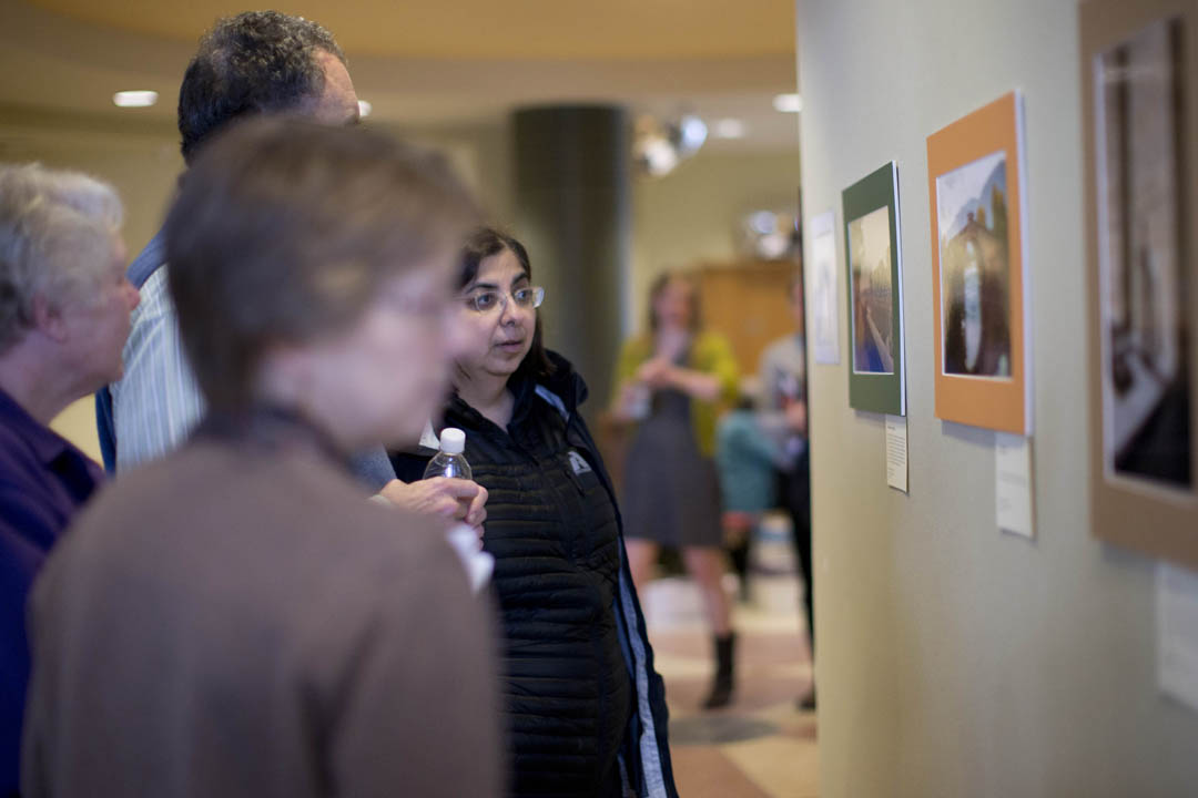 Visitors enjoy the annual Barlow Off-Campus Study Photography Exhibition. (Phyllis Graber Jensen/Bates College)