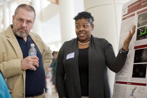 Jeff Sturgis '69, left, listens as Destany Franklin '14 discusses her neuroscience research during the 2014 Mount David Summit. (Phyllis Graber Jensen/Bates College)