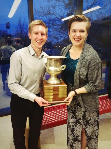 Jac Stewart (left) and Taylor Blackburn brandish the trophy for winning the U.S. Universities Debating Championship.