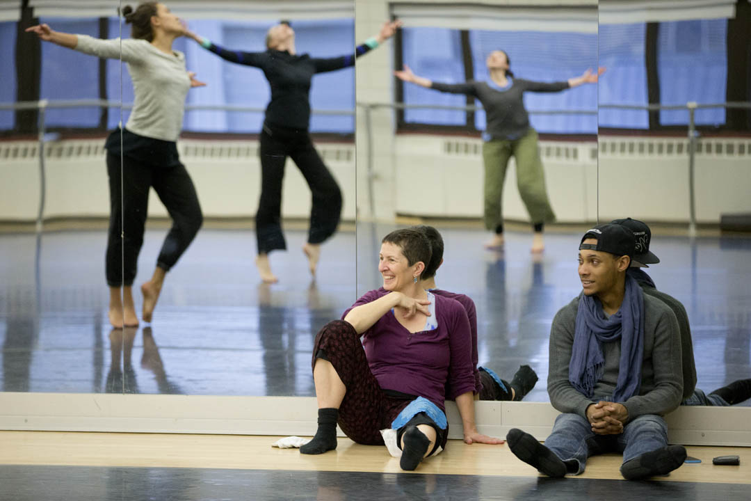 Associate Professor of Dance Carol Dilley and Leroy Barnes '15 of Woodbridge, Va., observe a rehearsal by visiting artists Kathleen Hermesdorf and Albert Mathias at the Marcy Plavin Dance Studios. (Phyllis Graber Jensen/Bates College)