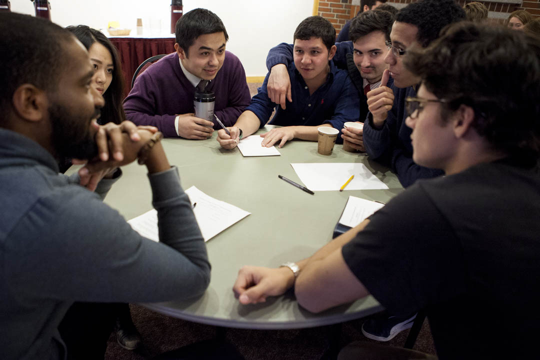 Students tackle an assignment from Joshua Macht '91, group publisher of Harvard Business Review Group, who participated in the Voices in Entrepreneurship speaker series. The series is part of the Purposeful Work initiative.  (Sarah Crosby/Bates College)