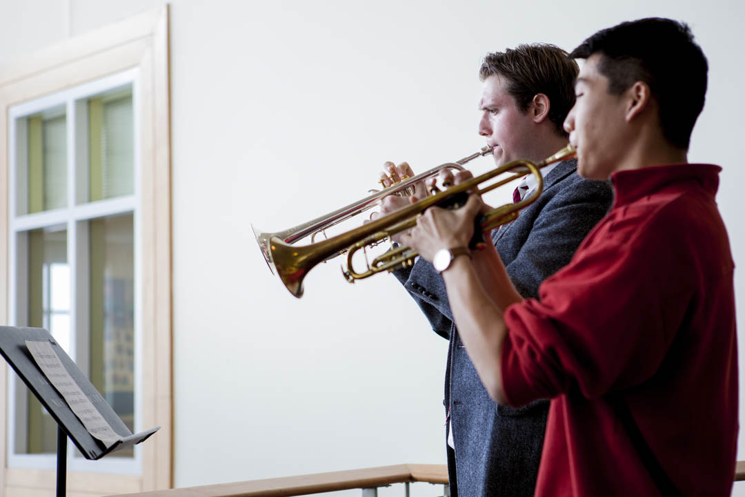 "Trumpeters Alexander Perrone '16 (left) of Natick, Mass., and James Jhun '16 of Lincoln, Mass., play Michael Rondeau's ""Fanfares of St. Charbel"" to celebrate the start of Mount David Summit in Perry Atrium, Pettengill Hall, on March 28. (Sarah Crosby/Bates College)"