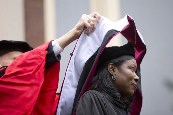 Isabel Wilkerson receives her honorary degree hood from Professor of Sociology Sawyer Sylvester. (Phyllis Graber Jensen/Bates College)