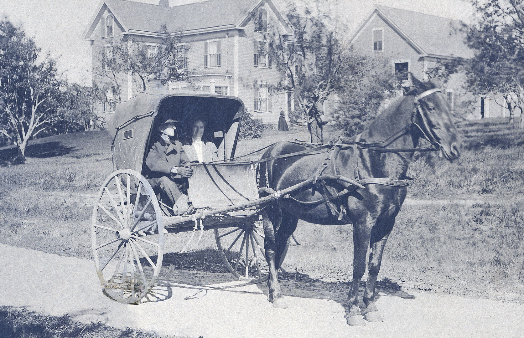 Alonzo Garcelon, seen here with his daughter on East Avenue in Lewiston, drove his one-horse shay to appointments all around town. Photograph courtesy Edmund S. Muskie Archives and Special Collections Library