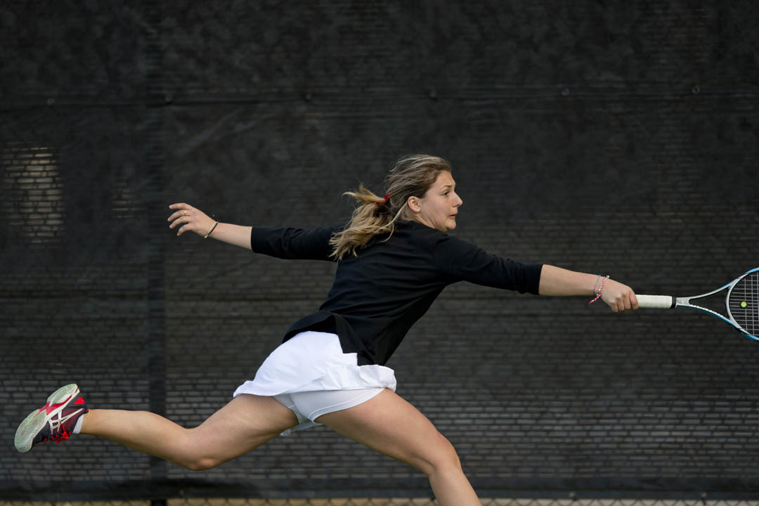 Elena Mandzhukova '15 of Lisbon, Portugal, reaches for a backhand during a match vs. Amherst. (Phyllis Graber Jensen/Bates College)