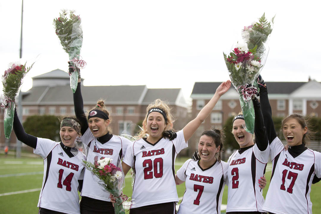 Lacrosse seniors give a cheer during a ceremony honoring seniors prior to the Bobcats' final home game. (Phyllis Graber Jensen/Bates College)