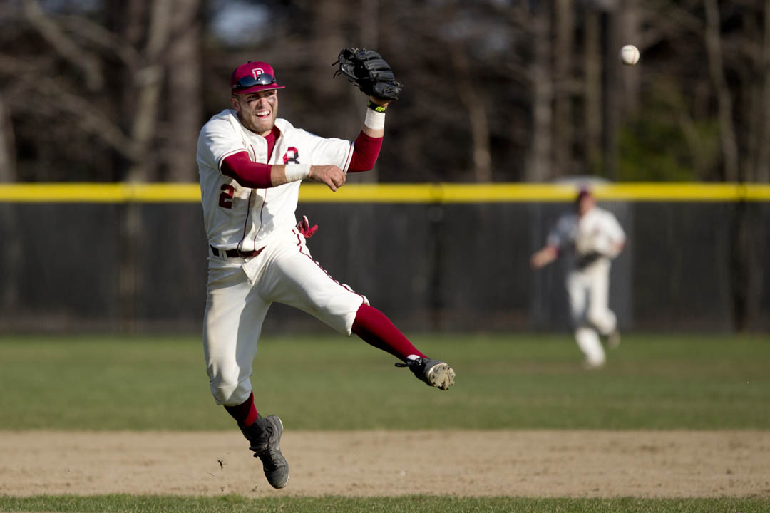 Conor Reenstierna '16 of Lincoln, Mass., throws to first for the final out of Bates' game vs. Colby. (Phyllis Graber Jensen/Bates College)