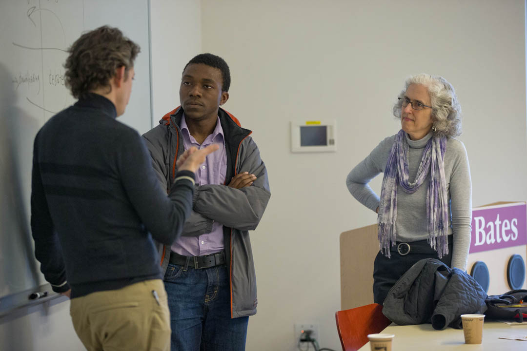 After class, visiting author and entrepreneur Thomas Goetz '90 speaks with Gideon Ikpekaogu '17 in the course Social Change Organizing and Advocacy. Sociologist Emily Kane is at right. (Phyllis Graber Jensen/Bates College)