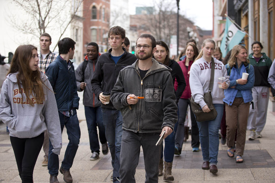 Craig Saddlemire '05, a documentary filmmaker in Lewiston, leads students on a tour of the downtown, part of a social-change organizing and advocacy course that he and other non-faculty practitioners are teaching this Short Term. (Phyllis Graber Jensen/Bates College)
