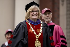Bates President Clayton Spencer beams during Commencement 2014. Behind her is geology professor and faculty marshal John Creasey. (Phyllis Graber Jensen/Bates College)