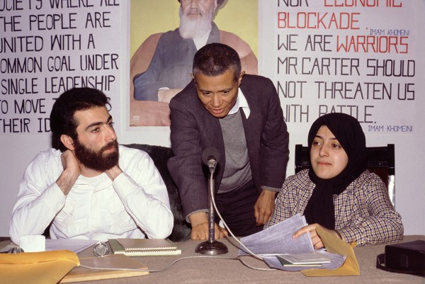 "Image likely taken on Feb. 13, 1980 in Tehran, Iran. William Worthy '42 (center) setting up a question-answer session at a Tehran hotel with Hossein Sheikholislam (left) and Massoumeh Ebtekar (right), spokespeople for the students who held 52 U.S. diplomats hostage for 444 days. Ebtekar, often interviewed by U.S. journalists during the crisis, was dubbed ""Screaming Mary"" by the media. Now a professor of immunology in Tehran, she talked to Matt Lauer of the Today Show last September about the status of women in her country. Sheikholislam, meanwhile, became Iran's deputy foreign minister and ambassador to Syria. In February 2008 he received the Louis M. Lyons Award for Conscience and Integrity in Journalism from Harvard's Nieman Foundation for Journalism."