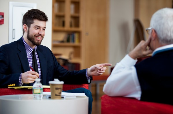 Matt Perejda '14 of Newry, Maine, talks with Stangle during a one-on-one meeting in Fireplace Lounge in Commons on March 5, 2014. (Sarah Crosby/Bates College)