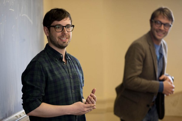 Jeremy Fisher '06 explains the art of the pitch as Ben Schippers '04 looks on. Fisher was a guest speaker in Schipper's Short Term course on digital innovation on May 6, 2014. (Phyllis Graber Jensen/Bates College)