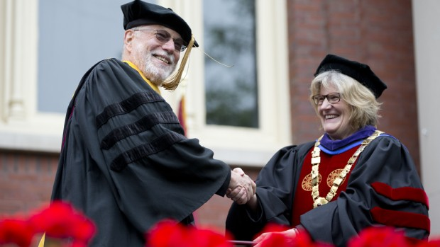 John Seely Brown receives his honorary degree from Bates President A. Clayton Spencer. (Phyllis Graber Jensen/Bates College)