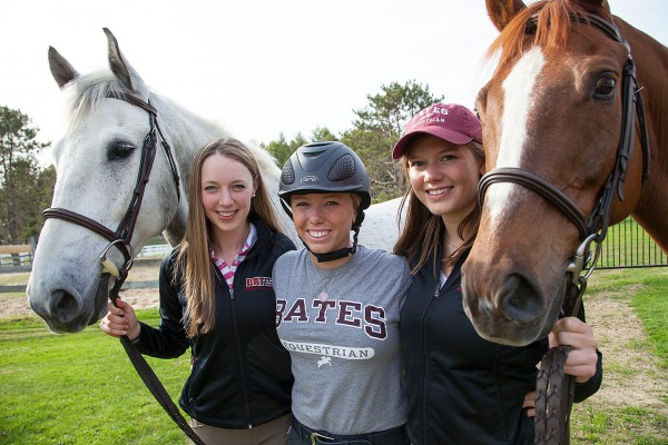 Otis (left) and Juno (right) flank Bates Equestrian Club members Katie Kirwin '15, Carolyn Attenborough '15 and Hannah Kiesler '16.