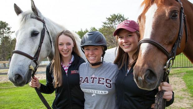 Otis (left) and Juno (right) flank Bates Equestrian Club members Katie Kirwin '15, Carolyn Attenborough '15 and Hannah Kiesler '16.