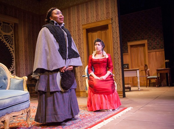 Brittany Davis '14 delivers her soliloquy as the character of Mrs. Givings (Singha Hon '14) listens. (Sarah Crosby/Bates College)