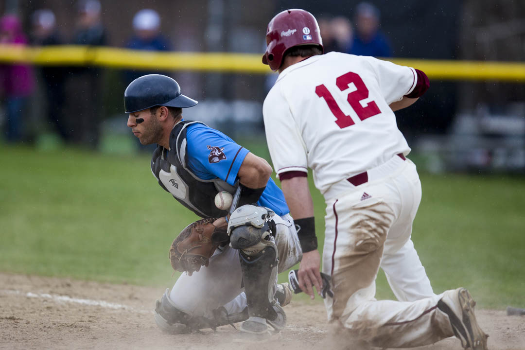 Rockwell Jackson '15 of Fort Worth, Texas, scores the walk-off winning run vs. Tufts on May 3 as Bates earned its first-ever berth in the NESCAC tournament. (Photo by Sarah Crosby/Bates College)