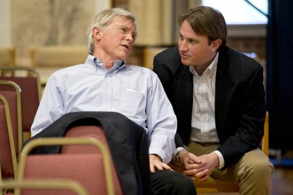 """Father and son entrepreneurs David Shaw and Ben Shaw '00 consult before their May 5 talk, """"Adventures in Business and Social Entrepreneurship,"""" part of the spring's """"Purposeful Work: Voices in Entrepreneurship"""" series. David Shaw returned to Bates at Commencement to receive an honorary degree. (Phyllis Graber Jensen/Bates College)"""