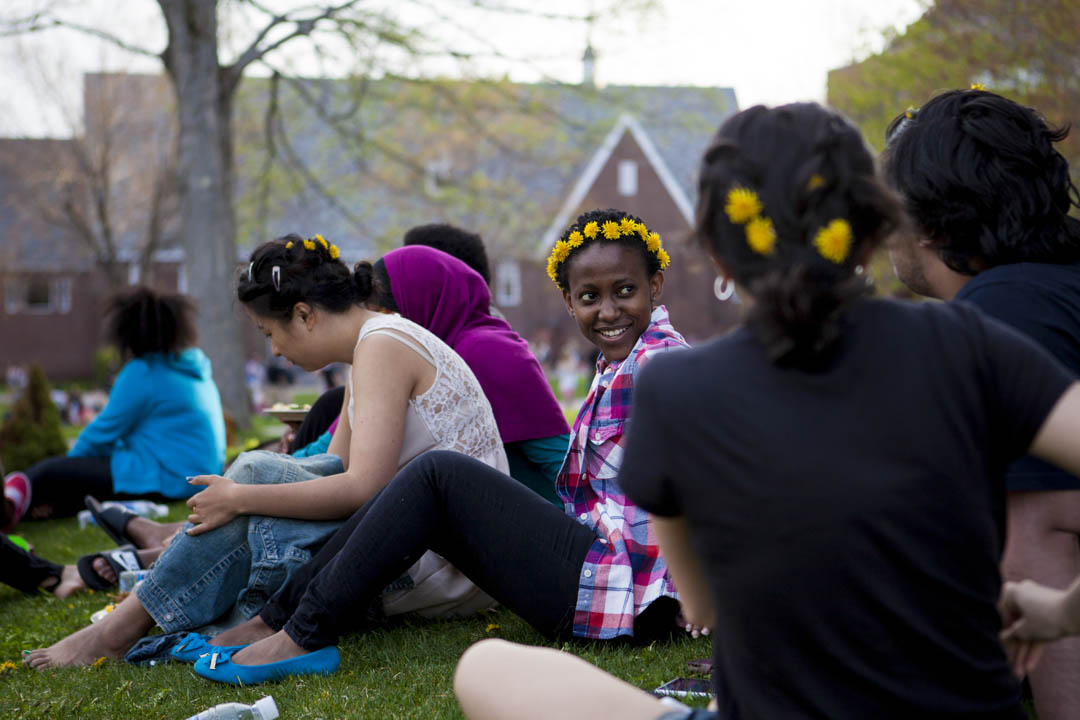 Neema Kafwimi '17 of Mbeya, United Republic of Tanzania, and friends wear dandelion crowns during the annual Block Party on the Library Quad, held May 10. (Sarah Crosby/Bates College)