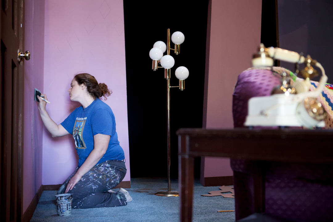 "Rachel Spence '14 of Edmonds, Wash., paints walls for the set of ""Little Egypt,"" staged during Short Term in Gannett Theater. The production emerged from the 2014 Theater Production Workshop, a course that creates a professional-style work environment for the college's top theater students. (Sarah Crosby/Bates College)"