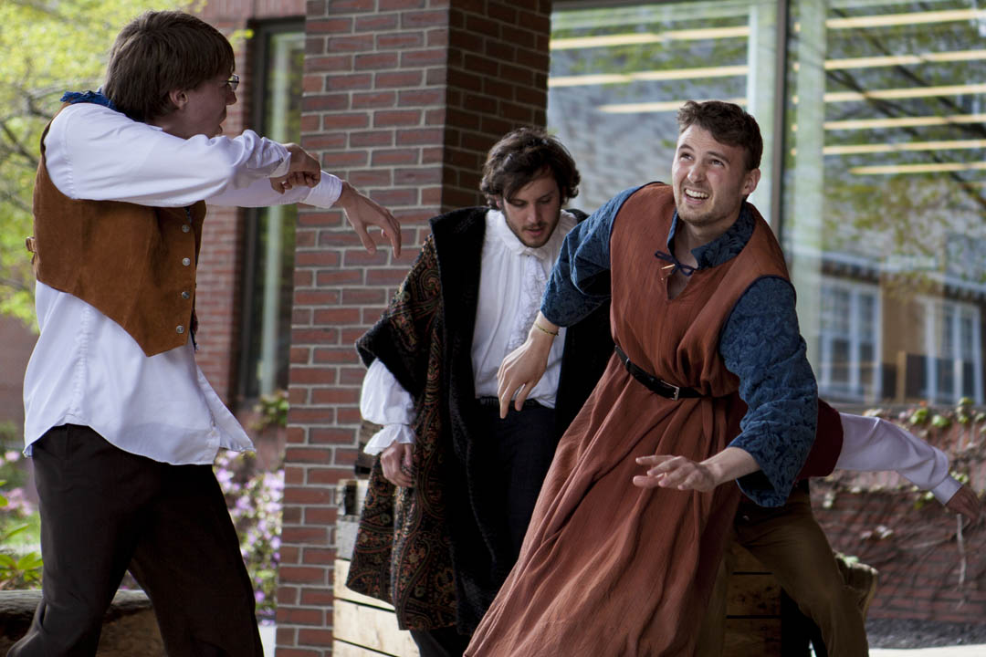"The Boatswain, Alonso and Gonzalo (Jackson Emanuel '15 of Cedar Park, Texas, Michael Stone '17 of Litchfield, N.H., and Daniel Jordan '14 of Washington, D.C.) struggle to stay on their feet during the storm scene in ""The Tempest,"" the Robinson Players' annual Shakespeare production during Short Term. (Sarah Crosby/Bates College)"