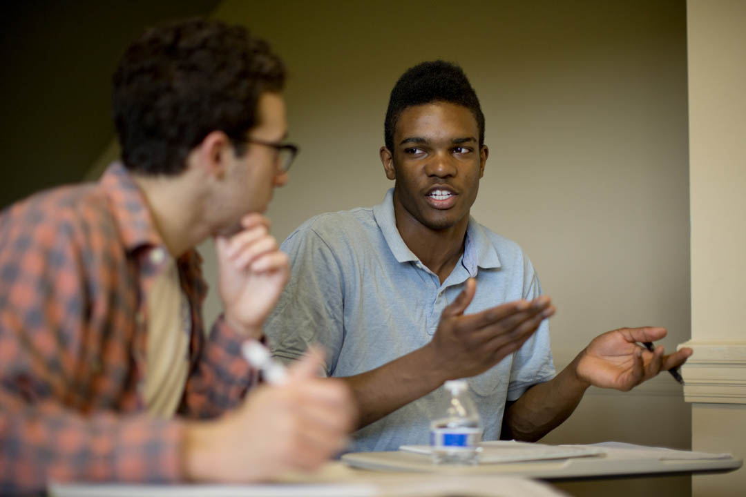 "Malcolm Delpeche '17 of Wilmington, Del., participates in ""Public Discourse,"" a Short Term rhetoric course taught by Jan Hovden, lecturer in rhetoric and director of debate. (Phyllis Graber Jensen/Bates College)"