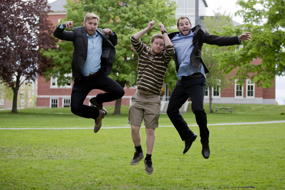 As they leave the Senior-Faculty Farewell Reception on May 22, three friends look lively on the Library Quad: John Barbadoro '14 of Concord, N.H.; Collin McCullough '14 of Plattsburgh, N.Y.  (hampered by a sore ankle); and Charlie Grant '14 of Portland, Ore. (Phyllis Graber Jensen/Bates College)