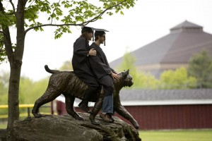 After Baccalaureate, the Bobcat carries two graduating seniors into the sunset. (Phyllis Graber Jensen/Bates College)