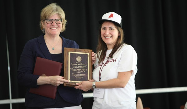 Katherine Papadonis Rogers '04, right, receives the Distinguished Young Alumni Award from President Clayton Spencer at the Annual Gathering of the Alumni Association on June 7, 2014. (H. Lincoln Benedict '09)
